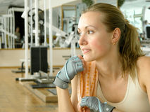 Sport08. Nice girl at the gym royalty free stock images