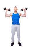 Sportar man att göra övningar med hantlar Fotografering för Bildbyråer