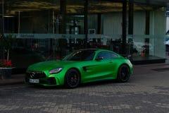 Sportbilen Mercedes-AMG GT R i gräsplan fotografering för bildbyråer
