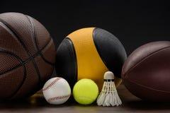 Sportbollar och fjäderboll Arkivbild