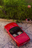 Sportcar on the street of the village of Kemer in Turkey in may. Sportcar on the street of the village of Kemer in Turkey. Old red car parked on the roadside in Royalty Free Stock Images