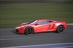 Sportcar veloce su una pista Immagini Stock