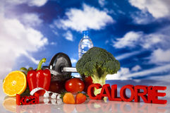 Sporten bantar, kalorin, måttband Arkivfoto