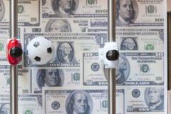 Sporten en geld Stock Foto's