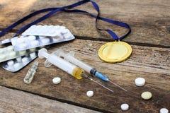 Sportenmedaille en geneesmiddelen stock afbeeldingen