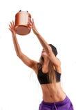 Sportenmeisje met kruik proteïne stock afbeeldingen