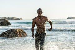 Sportenmens die in water lopen Royalty-vrije Stock Foto's