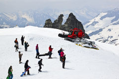 Sporters and snowplow at the Hintertux Glacier, Au Royalty Free Stock Photo