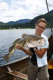 Sportfisher with big cod Royalty Free Stock Image