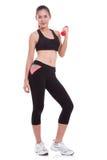 Sportfrau, die Übung mit anhebenden Gewichten tut Stockfotografie