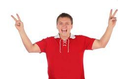 Sportfreund mit den Siegfingern Stockbild