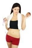 Sportief meisje met het meten van band en appel in handen Royalty-vrije Stock Afbeeldingen