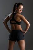 Sportig flicka med muskler royaltyfria foton