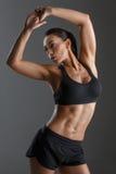 Sportig flicka med muskler royaltyfria bilder