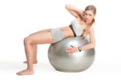 Sportig flicka på boll Royaltyfria Foton