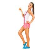 Sportig flicka som rymmer ett äpple Royaltyfri Bild