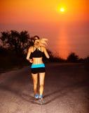 Sportig löparekvinnlig arkivfoto