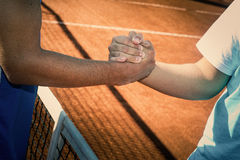 Sportiness, Fair play. Tennis match challenge hands. Two men shake hands at the beginning or at the end of a tennis match. gesture of friendship in sport Stock Photography