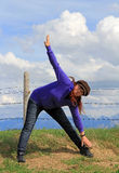 Sporting activity in nature. A woman doing gymnastics and stretching exercises in nature. Sporting activity in nature Stock Photography
