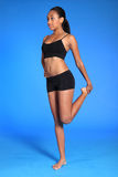Sporting African American woman thigh stretch Stock Photos
