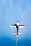Sporting airplane. Old single engine plane JUAK-52 flies up vertically in a blue height Royalty Free Stock Photo