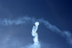 Sporting airplane executing aerobatics manoeuvre Royalty Free Stock Photo