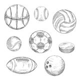 Sporting balls and hockey puck sketch icons Royalty Free Stock Image