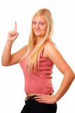 Sporting blonde woman in red shirt Stock Image