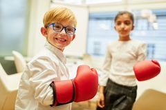 Business children as businessmen during boxing training. Sporting Business Children as businessmen during boxing training for stress reduction stock photos