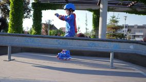 Sporting competition, kid into roller gaining speed at Skate Park stock video footage
