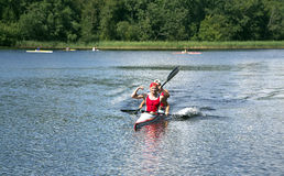 Sporting competitions on kayaks and canoe. LATVIA, BALDONE, JULY, 27, 2014 - Sporting competitions on kayaks and canoe in Baldone, Latvia royalty free stock photo