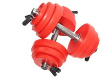A sporting equipment. Two red dumbbells. Isolated over white Stock Photo