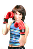 Sporting girl. Boxing girl in red gloves on a white background Royalty Free Stock Photo