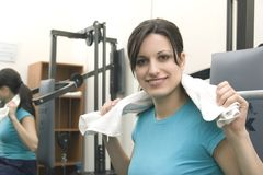 Sporting girl. Young woman goes in for sport in the gym Stock Image