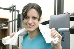 Sporting girl. Young woman goes in for sport in the gym Royalty Free Stock Photo