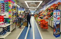 Sporting goods store Sportmaster, Mogilev, Belarus. MOGILEV, BELARUS - SEPTEMBER 28, 2016: Unidentified people choose items for outdoor activities in sporting royalty free stock photo