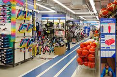 Sporting goods store Sportmaster, Mogilev, Belarus. MOGILEV, BELARUS - SEPTEMBER 28, 2016: Unidentified people choose items for outdoor activities in sporting Stock Images