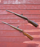 Sporting gun. On the wood wall Royalty Free Stock Photos
