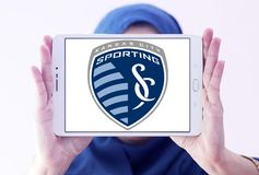 Sporting Kansas City Soccer Club logo. Logo of Sporting Kansas City Soccer Club on samsung tablet holded by arab muslim woman. Sporting Kansas City is an Stock Image