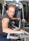 Sporting man is engaged in training in fitness center in a gym on trainers.Close up Stock Images
