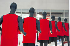 Sporting mannequins. Row of sporting mannequins in red Royalty Free Stock Photography