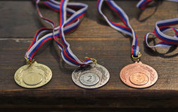 Sporting medals. Situated on the table royalty free stock photos