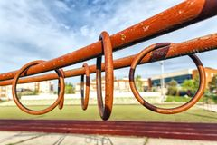 Sporting metal rings on uneven bars royalty free stock images