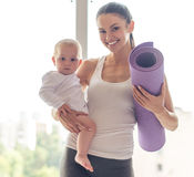 Sporting mom and baby stock photography