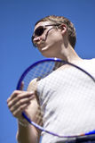 Sporting A Racquet. Tennis Player Sporting A Racquet And Pair Of Sunglasses Royalty Free Stock Photography
