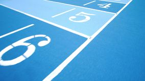 Sporting running tracks in blue colors with diferent numbers. Numbers of lanes. Sporting running tracks in blue colors with diferent numbers. Running track with stock video