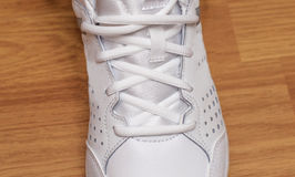 Sporting white sneakers with laces Stock Photography