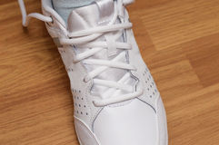 Sporting white sneakers with laces Royalty Free Stock Photo