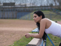 Sporting woman rely on sports equipment Royalty Free Stock Images