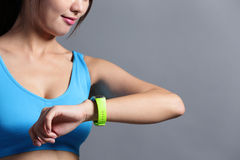 Sporting woman use wearable watch Royalty Free Stock Image
